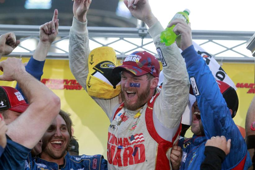 Dale Jr. celebrates after 1st Martinsville win (courtesy: Daily Press)