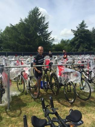 Coach Phil Murphy racking his bike