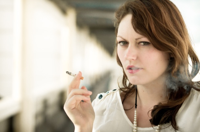 Image of a girl smoking which illustrates our article about Why Don't Women Smoke During Pregnancy.