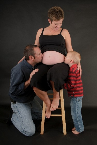 Family picture reveals new baby is coming - Our first baby is baking :)