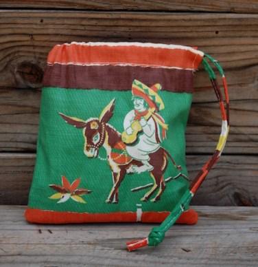 Dust bag-man-on-donkey