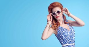 Top 2018 fashion tips Redhead Model in Sexy Jumpsuit, woman in Trendy Summer Dress. Stylish wavy hairstyle, fashion Sunglasses, Summer Floral Outfit. Glamour fashion pose. Playful Beauty Girl, Luxury summer Lady