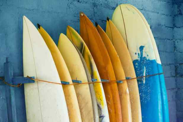 Set Of Different Color Surf Boards In A Stack By Ocean.bali, Ind