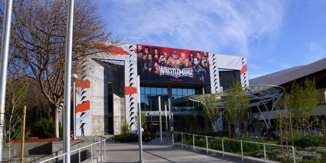 Wrestlemania poster featuring wrestling superstars