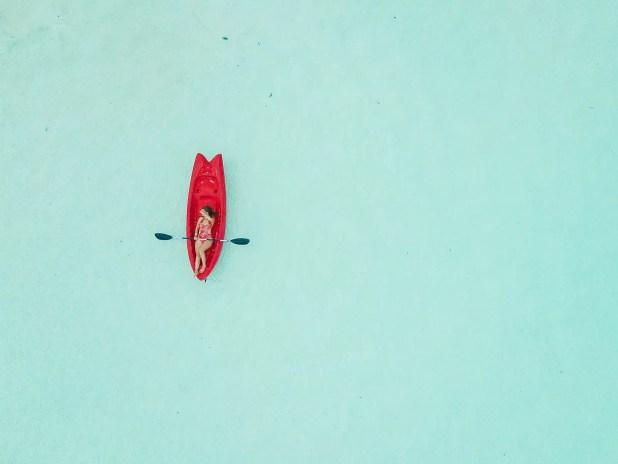 woman kayaking by Astuto Travel