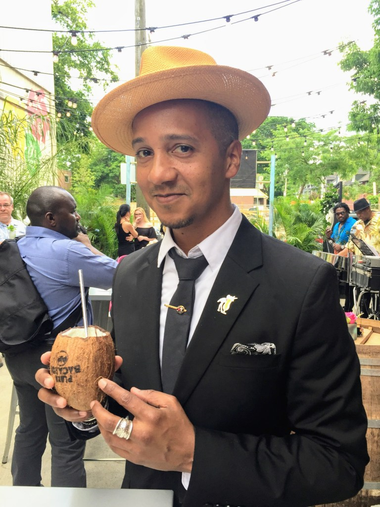 Juan holding coconut cocktail