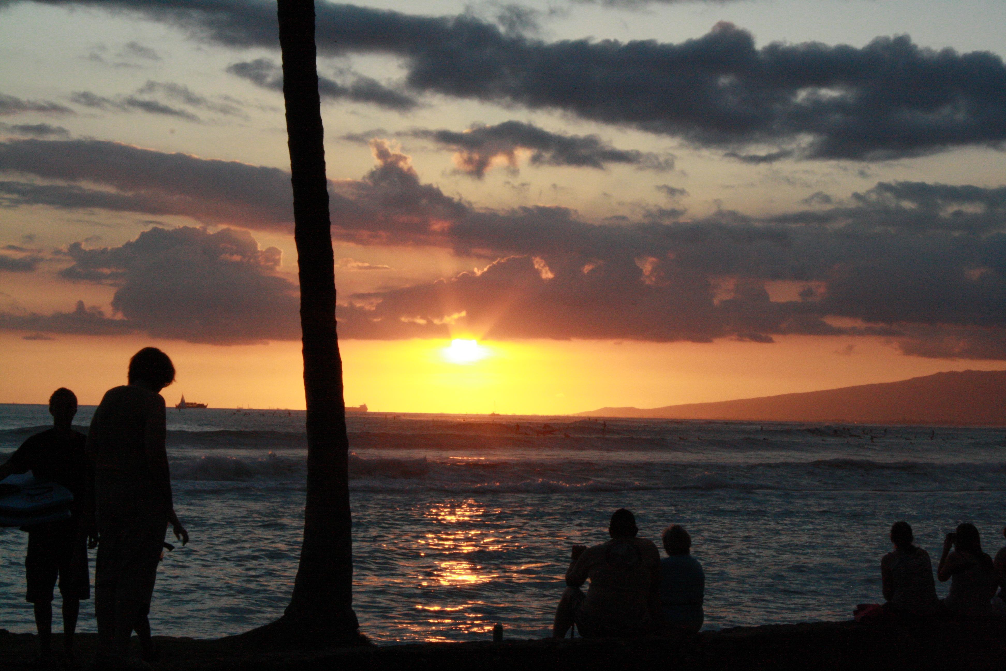 Sunset on Waikiki Beach, O'ahu for Ellen Blazer's travel blog To Travel and Bloom