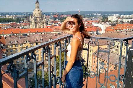 Ellen looking over Dresden, Germany from the bell tower of Kreuzkirche Cathedral, for Ellen Blazer's travel blog To Travel and Bloom