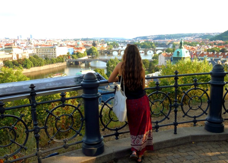 Ellen looking out over Prague, Czech Republic from Letna Park, for Ellen Blazer's travel blog To Travel and Bloom