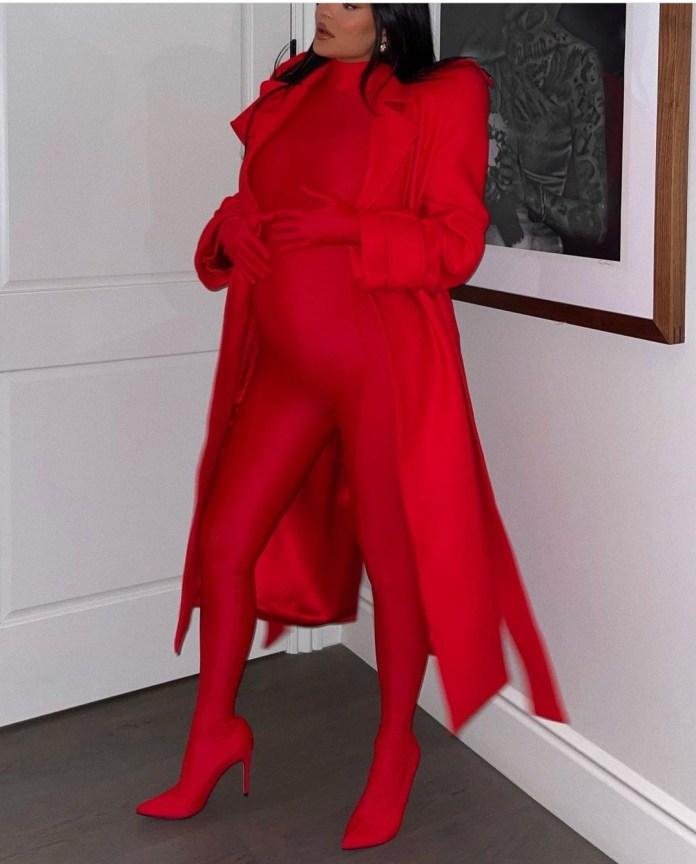 Kylie Jenner displays growing baby bump in red figure-hugging bodysuit (photos)