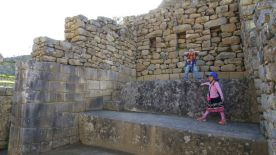 """Performing """"Let It Go"""" on what appears to be a stage in the women's quarters of Machu Picchu"""