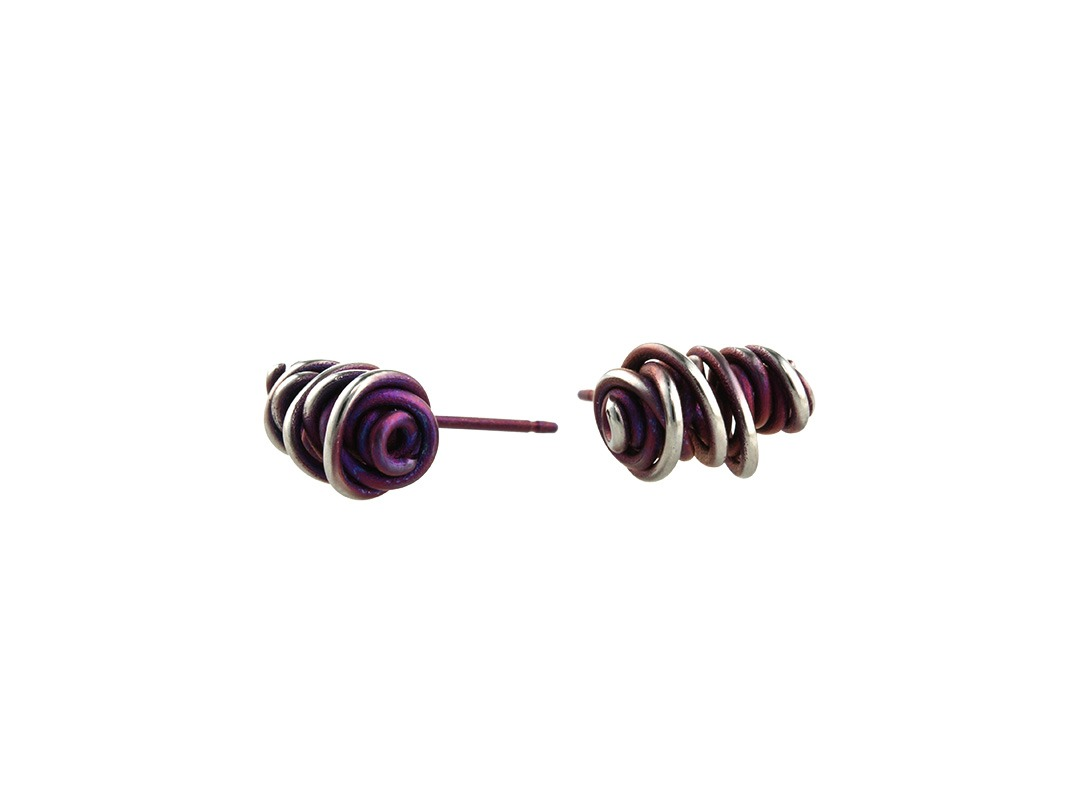 Twisted vine studs on TouchTitanium.com Our vine jungle studs are chaotic fusions of twists and colour, measuring approximately 12mm square. Bright colours available, all with a lightly polished finish, creating an aged look. Titanium butterfly clasps are included with all studs. These are hypoallergenic and very wearable.