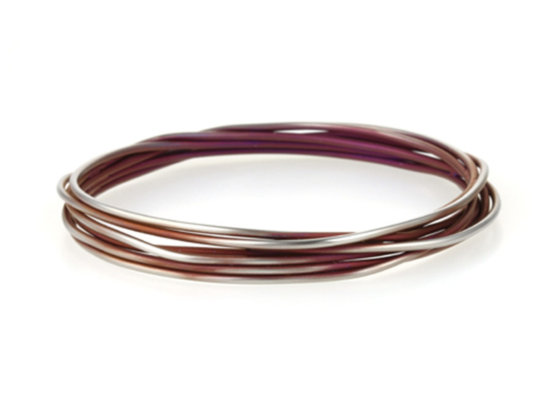 Twisted vine bangle on TouchTitanium.com Strong, bright titanium bangles. Handmade in the UK and available in our wide range of signature colours for you to choose from. All are hypoallergenic and safe to wear, whatever your skin type may be.  <strong>Please choose your size before selecting a colour.</strong>