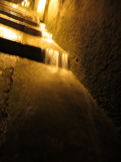 Heavy rain making a waterfall down the steps in Dubrovnik