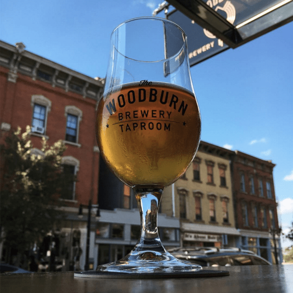 Drinking a beer at a window facing Woodburn Avenue