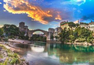 Mostar is a city in southern Bosnia and Herzegovina, straddling the Neretva River. It's known for the iconic Stari Most (Old Bridge)