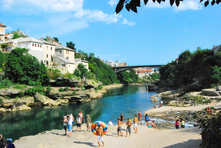 beach-under-the-old-bridge-in-mostar-travel-stories-min