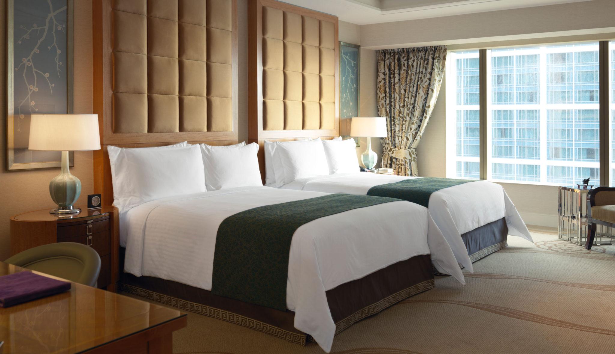 two-queens-deluxe-suite-bedroom