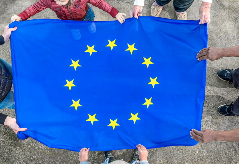 european-union-flag-holding-hands