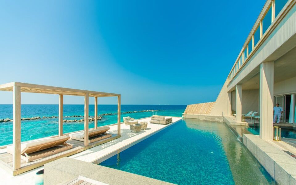 architectural photography of gray granite swimming pool and outdoor lounge at beach side