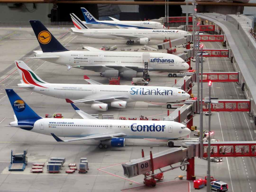 condor airplane on grey concrete airport jobs in travel and tourism