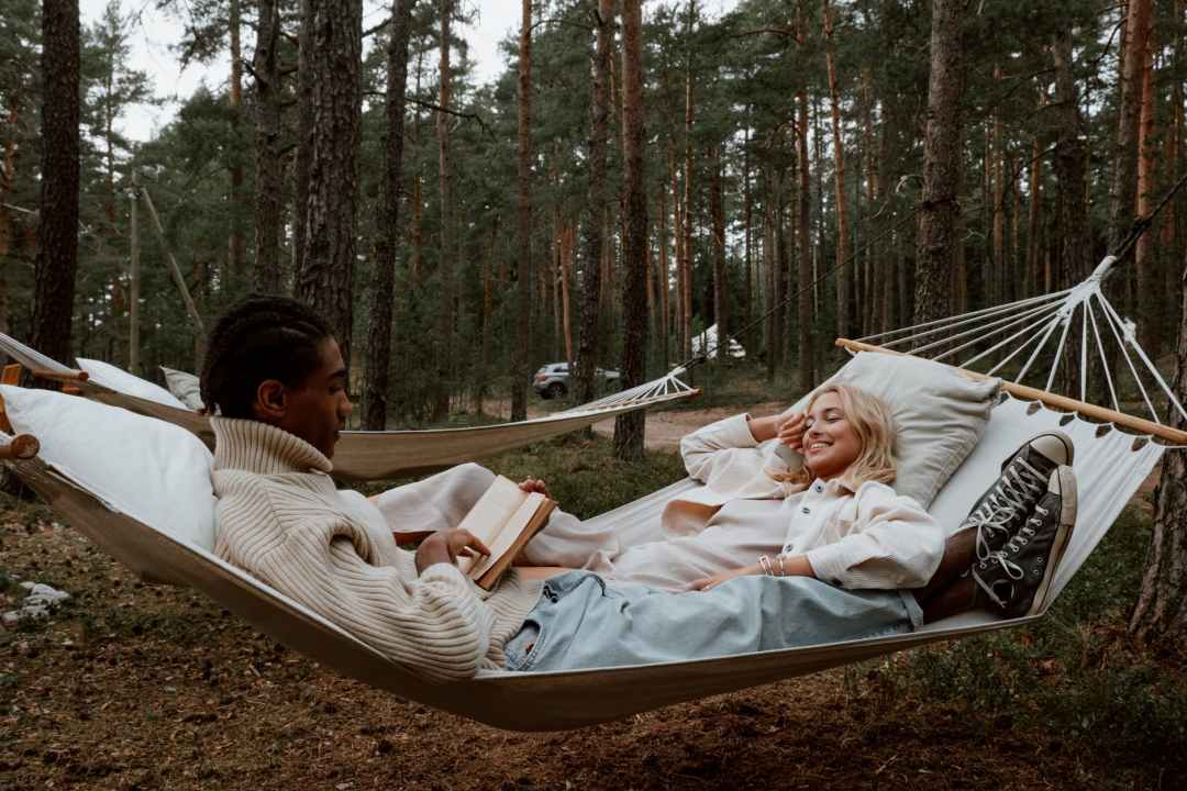 man and woman lying on hammock jobs in travel and tourism