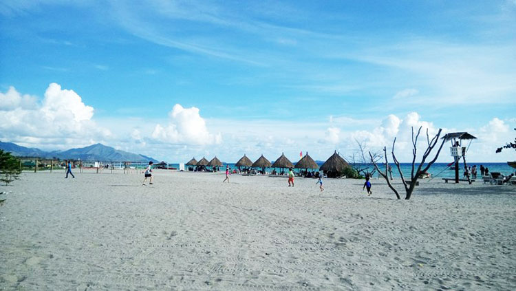 Crystal Beach Resort Zambales - vast sand with nipa huts