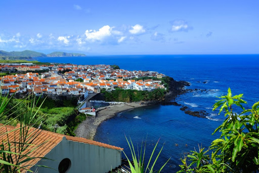 Sao Miguel Maia Azores Beach and restaurant with houses for sale on summer day
