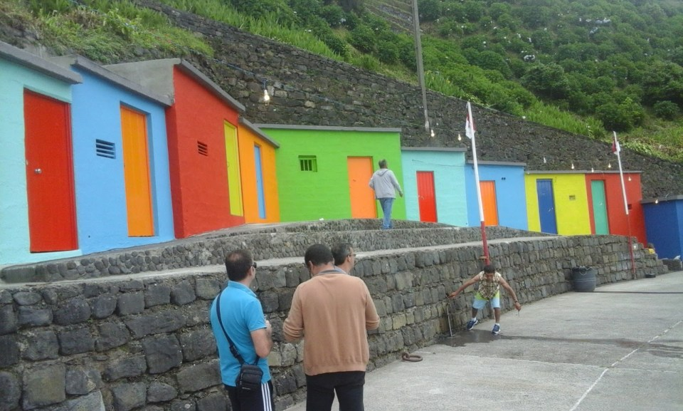 colorful houses on fishing village in sao miguel real estate market