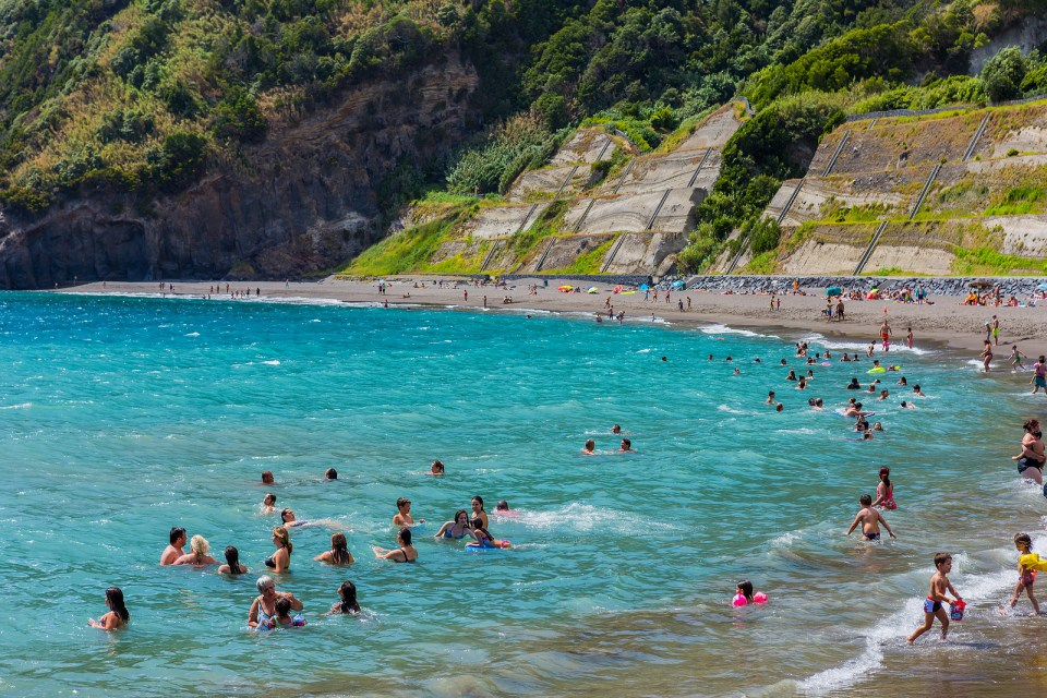 azores sao miguel beach during summer covid but busy praia do fogo