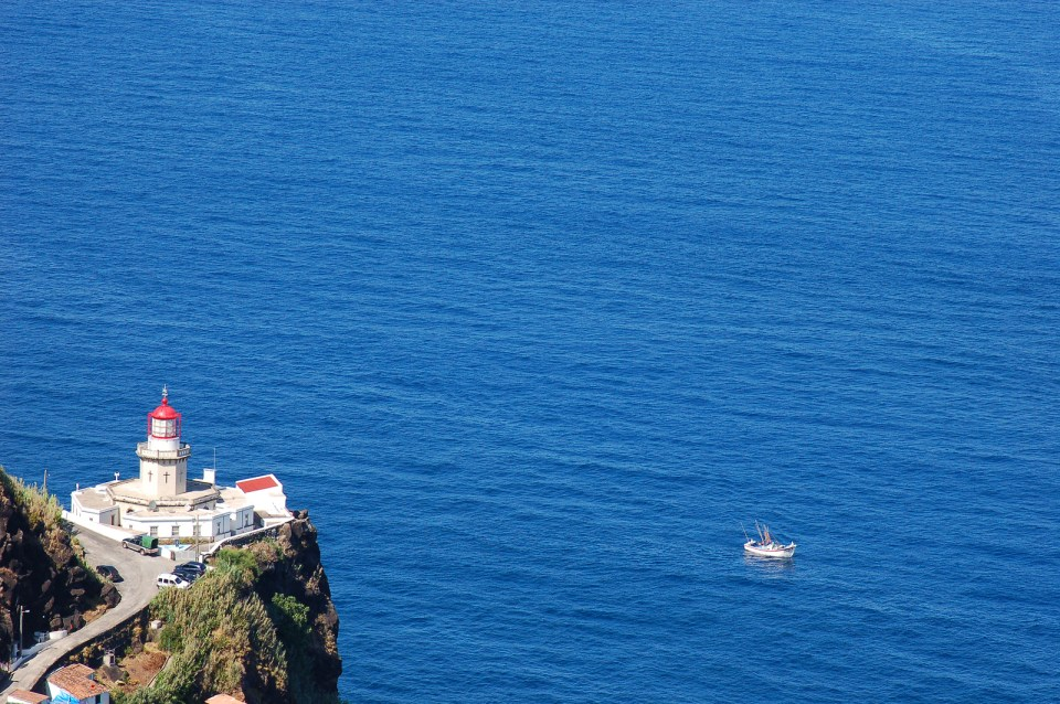 Arnel Lighthouse In Azores Islands, fishing boat Sao Miguel