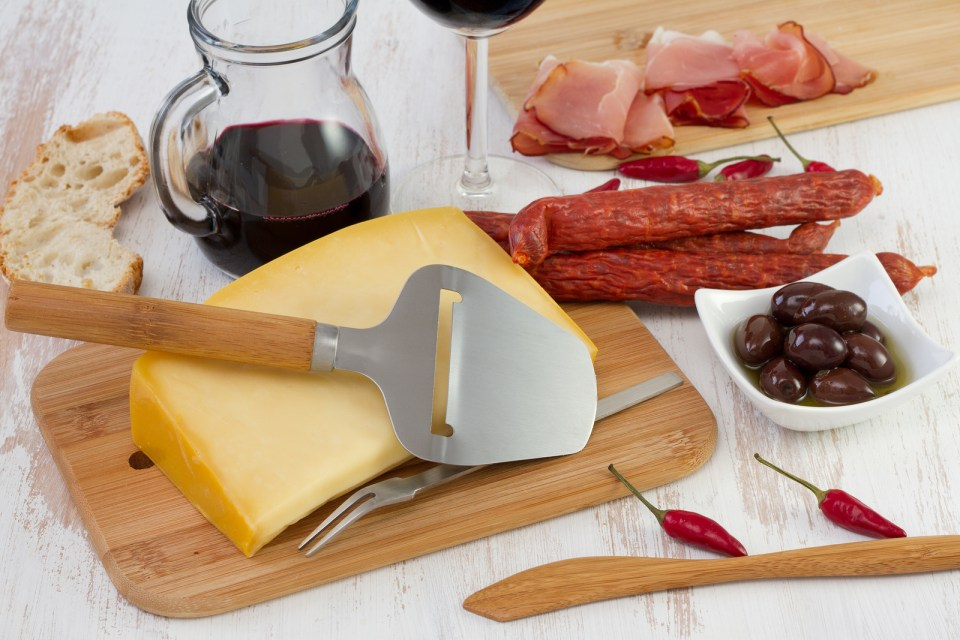 This image has an empty alt attribute; its file name is bigstock-cheese-with-sausages-olives-a-40306561.jpg