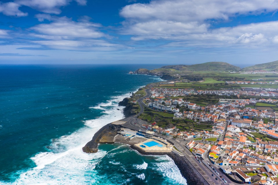 Aerial view of Atlantic coast at Ribeira Grande. Blue water and