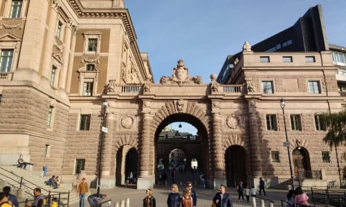 Walking along the Swedish Parliament on a tour of Gamla Stan