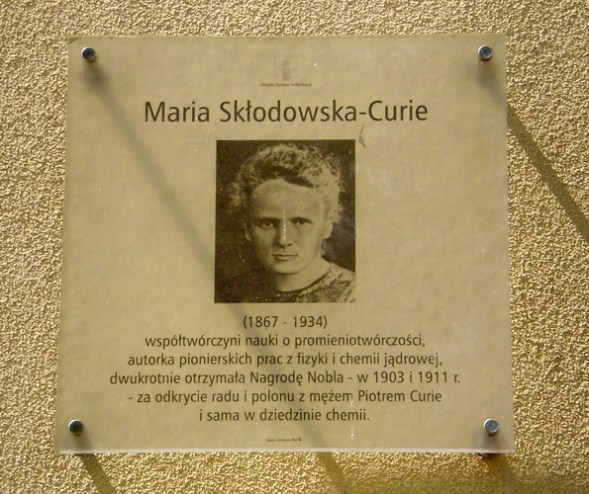 a plaque in M. Curie Street in Warsaw