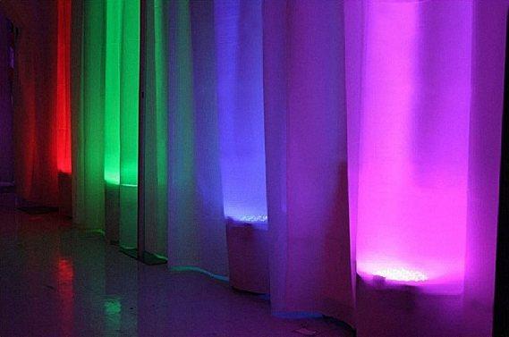 pipe and drape with rainbow lighting