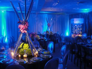 floral centerpieces with pin spot lighting on event tables