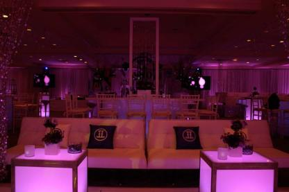 mitzvah event furniture, illuminated tables, and pink lighting
