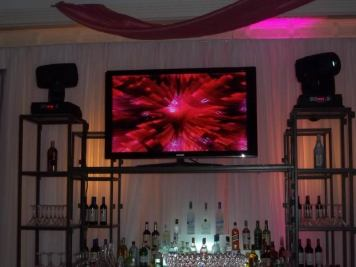 Flatscreen-video-rental-on-shelf-bar