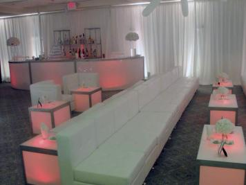 white lounge decor and pink illuminated furniture