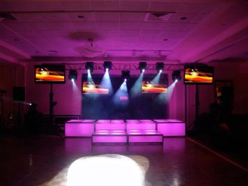 pink LED stage decks, video screens, theatrical lighting