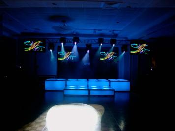 dark blue LED stage decks, video screens, theatrical lighting