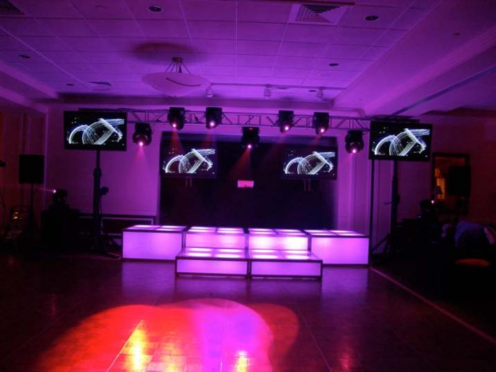 purple LED stage decks, video screens, theatrical lighting