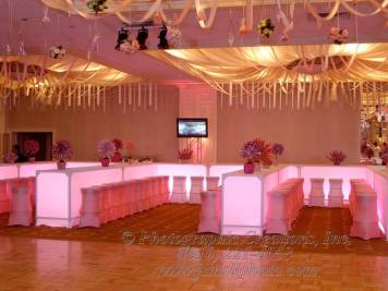 illuminated tables with pink matching ccovered chairs