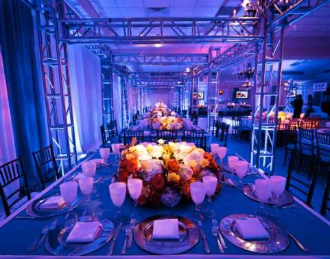 event tables with truss and floral centerpieces