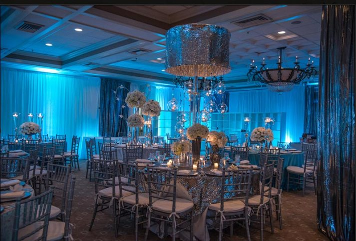 Event-with-uplighting-on-pipe-and-drape