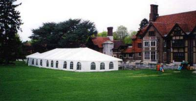 Giant-outdoor-tent-rental-with-fancy-archway-windows