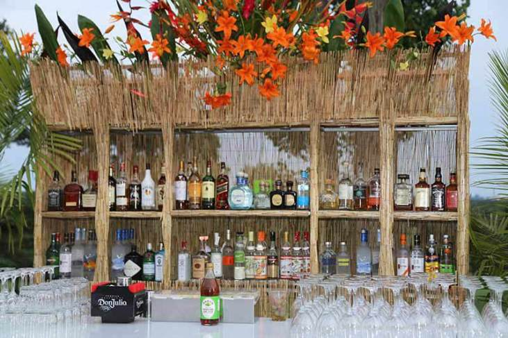 Havana-Tiki-Bar-Rental-with-glasses-and-floral-treatment