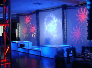 Lighting-effects-on-wall-in-3-colors-and-on-dance-floor