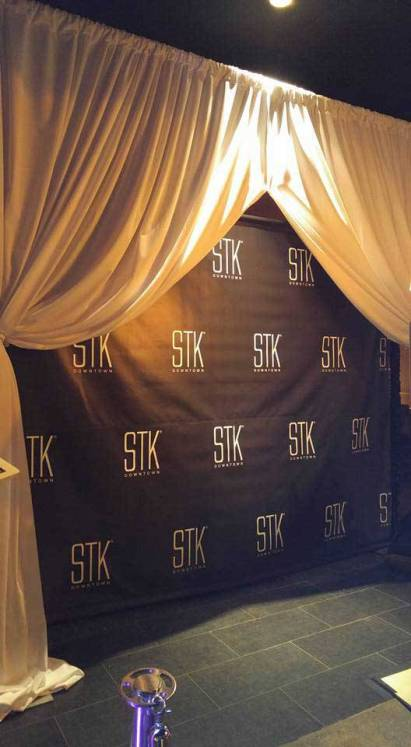 White curtains with black and white step and repeat